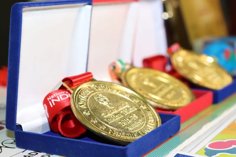 uploads/Olympiad-functions-and-Organization/Olympiad Topper Winning Medals.jpg