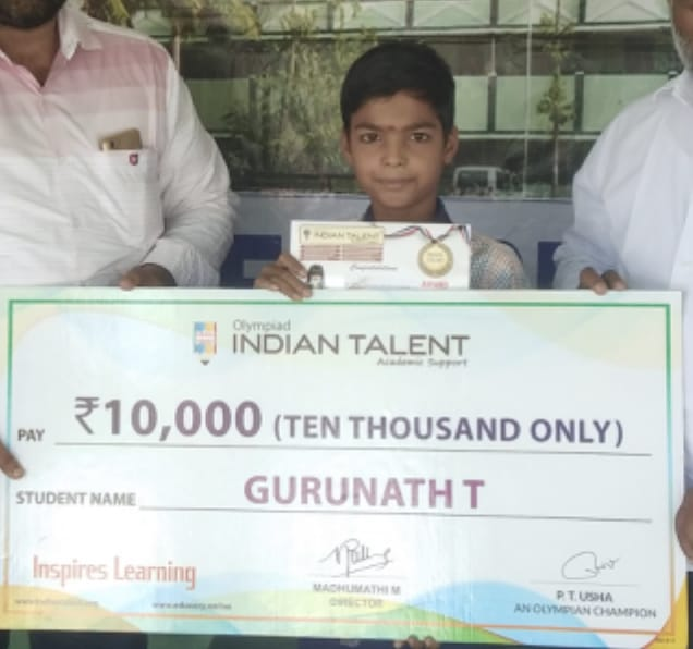 uploads/Olympiad-functions-and-Organization/Olympiad Winner With School Cheque.jpg